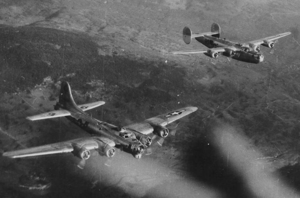 A B-17G of the 99th Bomb Group in formation with a B-24